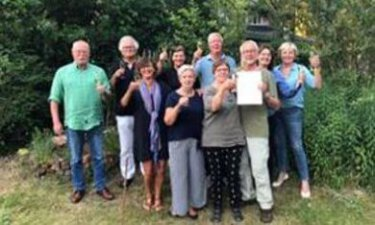 De 9 initiatiefnemers van Blue Zone Dorado Noordenveld met procesbegeleider Fenna Bolding
